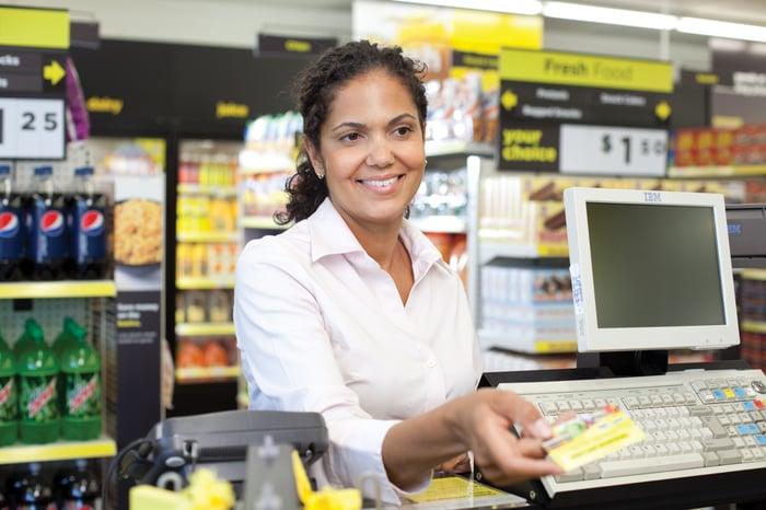 Woman at checkout counter