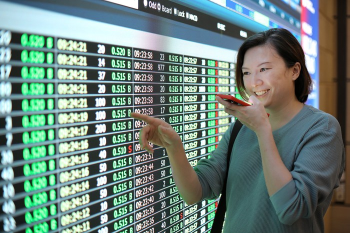 Woman smiling in financial exchange center