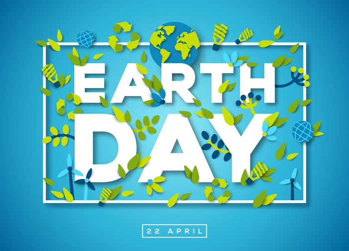 The words Earth Day on blue background with earth image and green leaves