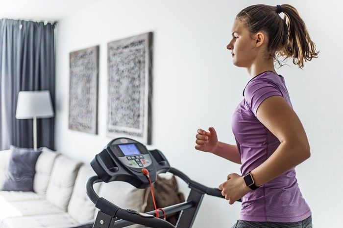 Lady running on treadmill at home