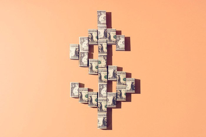 Several dollar bills in the shape of a dollar sign.
