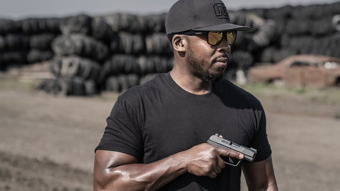 Man holding the Ruger Max-9 pistol