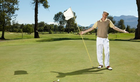 Smiling older man on golf course_GettyImages-82819685