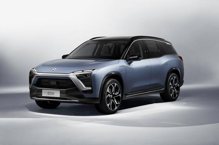 A NIO ES8 EV SUV in a showroom.