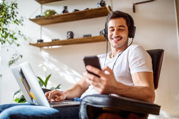 Man listening to audio.