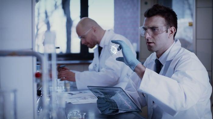 Scientists work in front of computers on coronavirus vaccine development.