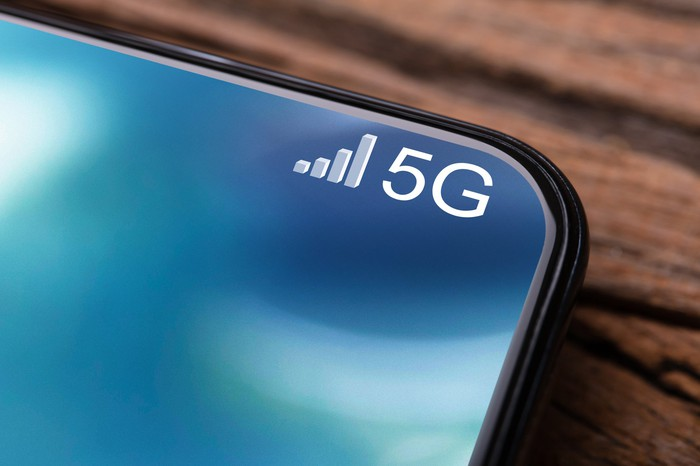 A cellphone with 5G and four ascending bars in the corner of the screen