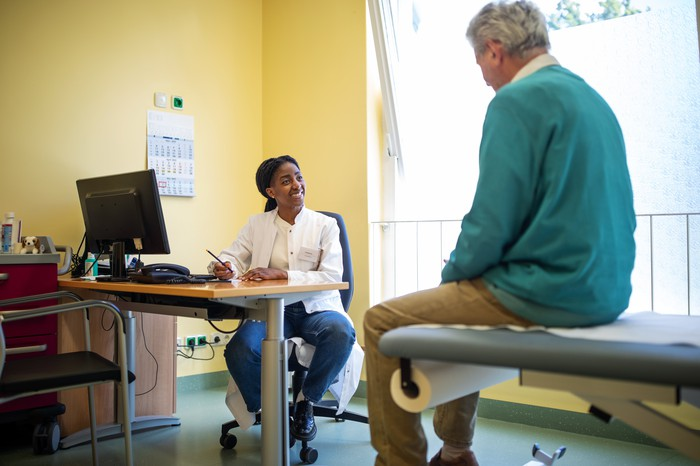 Doctor consulting with elderly patient.