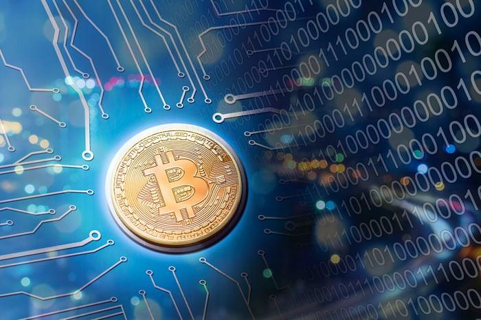 Bitcoin concept art on blue field.