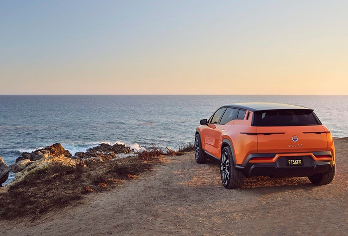 Fisker Ocean SUV parked on a cliff overlooking the ocean