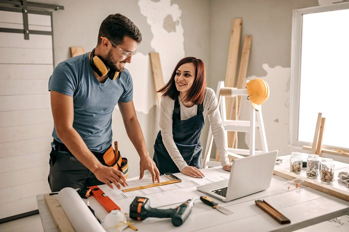 man and woman working on a home improvement project