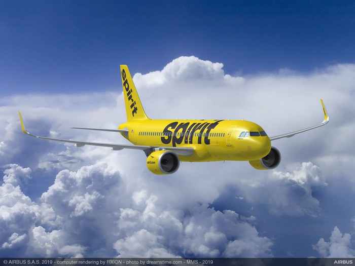 A rendering of a Spirit Airlines jet in flight, with clouds in the background