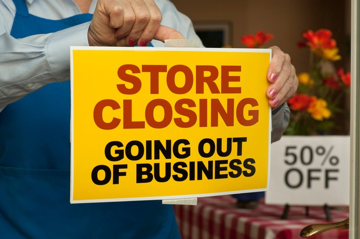 """""""store closing"""" sign in the window"""