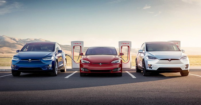 Tesla cars charging at a Supercharger station.