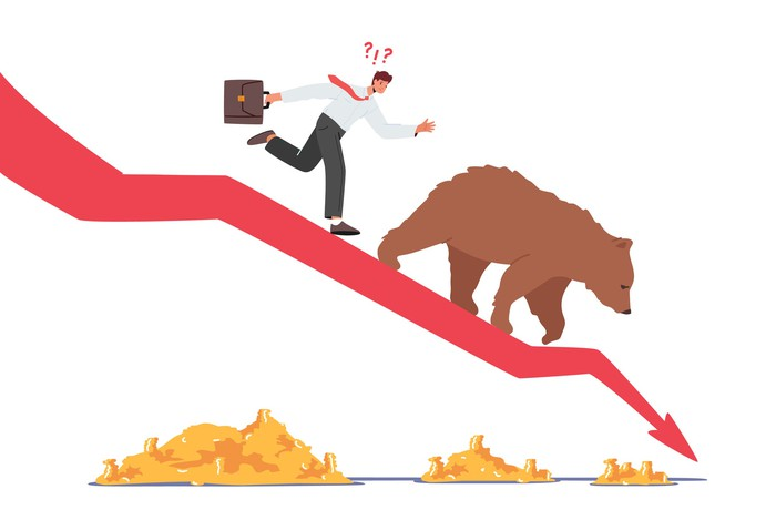 Panic selling as man in tie follows a bear down a red arrow