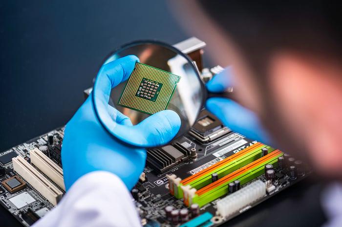 An engineer examining a chip.