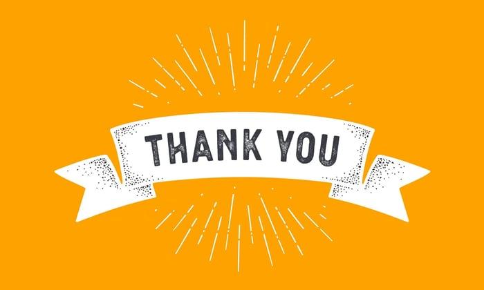 Bannière de lecture Merci sur fond orange.