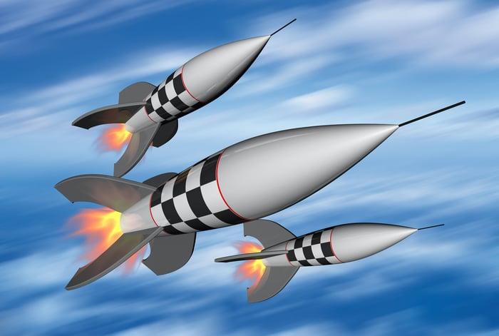 Drawing of three rockets in flight.