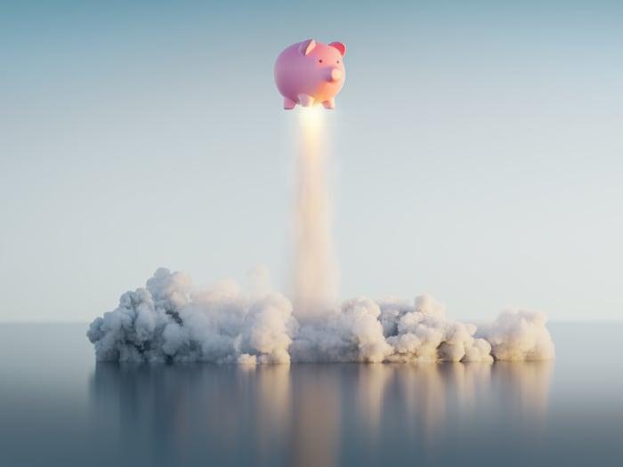 A piggy bank taking off like a rocket