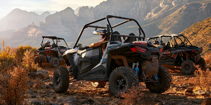 three ATVs in the desert mountains