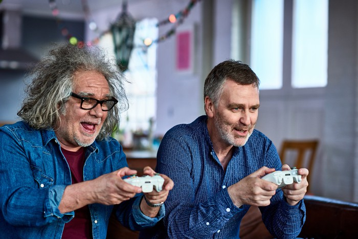 Two senior citizens playing a video game