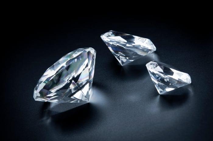 Three glistening diamonds are shown.