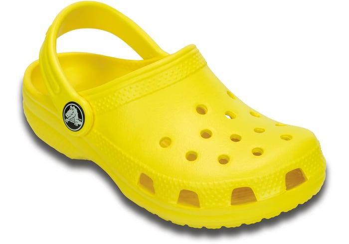 A single Crocs shoe in bright yellow.