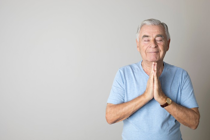 Retired man in peaceful meditation