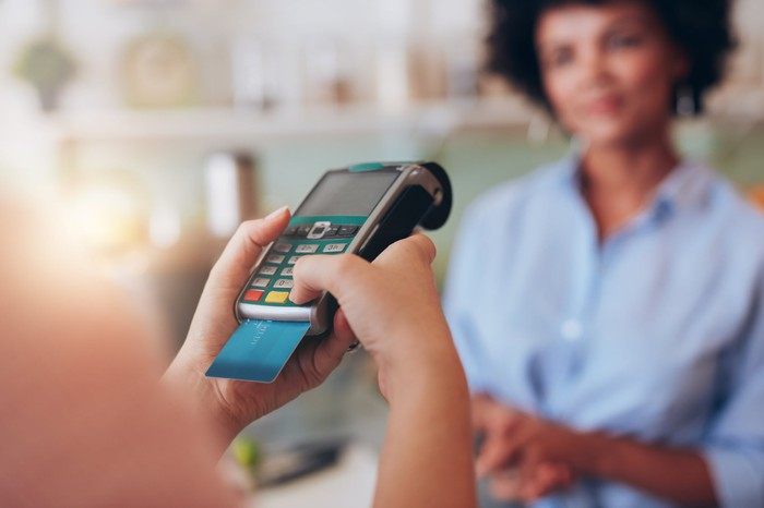 Payment card being used for a point-of-sale transaction.