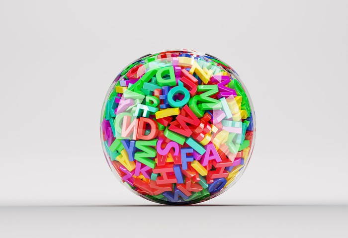Clear ball filled with colorful letters of the alphabet.