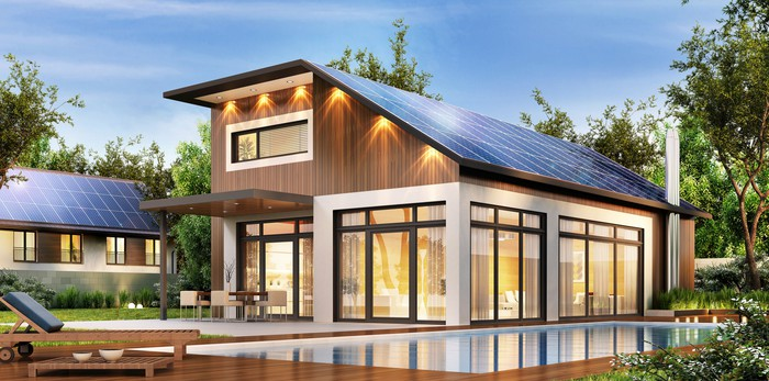 Large modern house with solar panels on the roof.