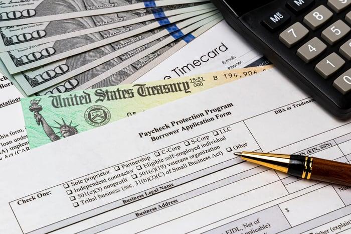 Paycheck Protection Program application sits on a desk.
