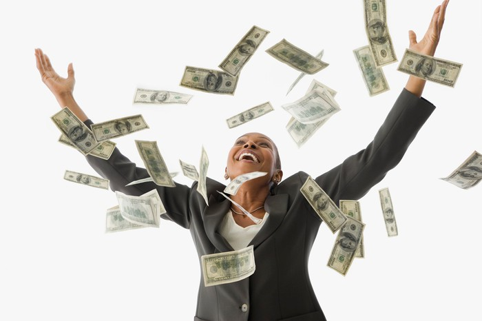 Woman with cash raining down around her