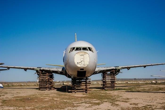 Retired airplane being taken apart for scrap