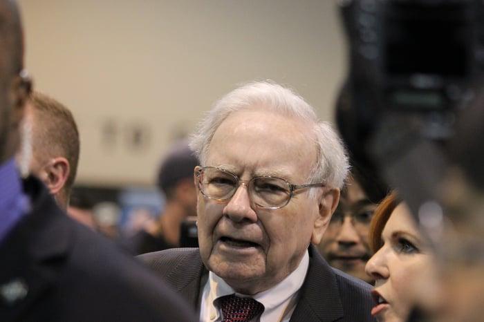 Warren Buffett in a crowd of people