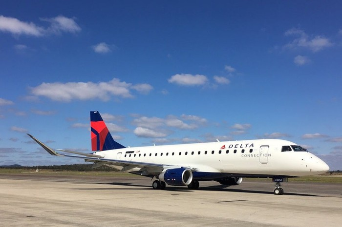 A SkyWest regional jet in the Delta Air Lines livery
