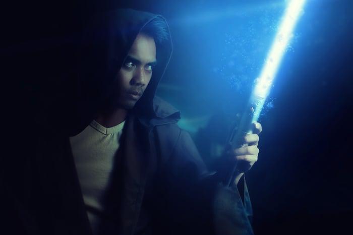 A man with a lightsaber.