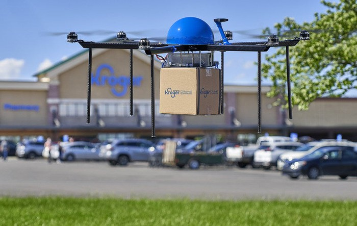 Drone carrying Kroger box.