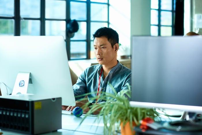 A man using a computer.