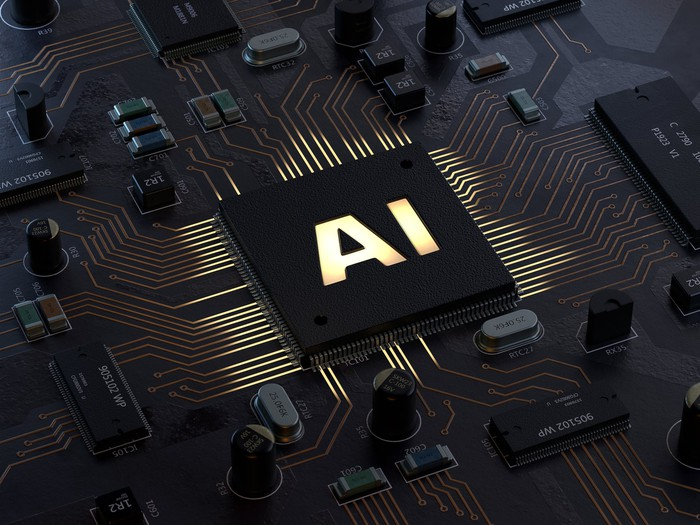 """A microchip with the letters """"AI"""" on it."""