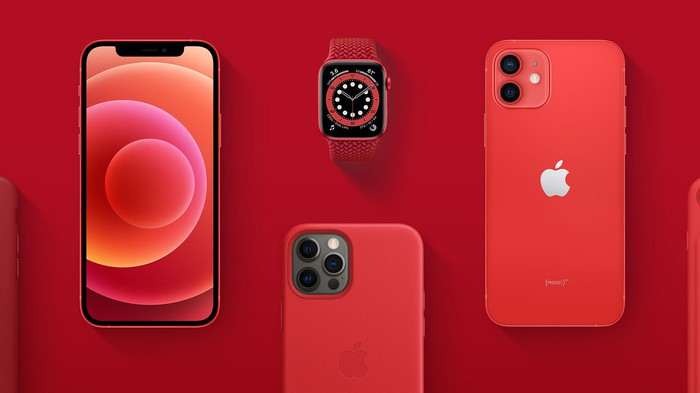 Red Apple iPhone 12 and Apple Watch series 6 against a red background.