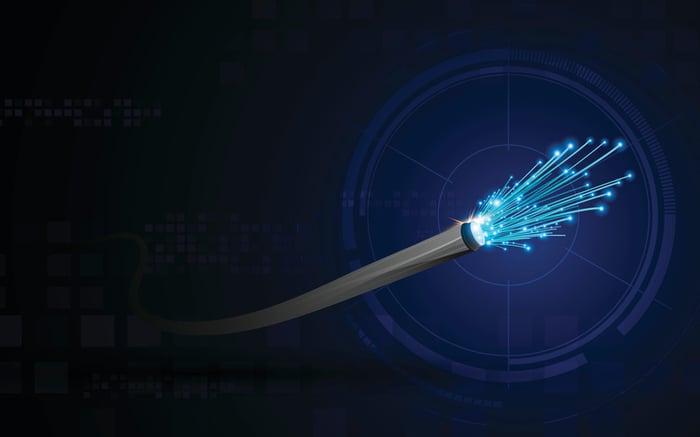 Illustration of strands of light emanating from fiber optic laser