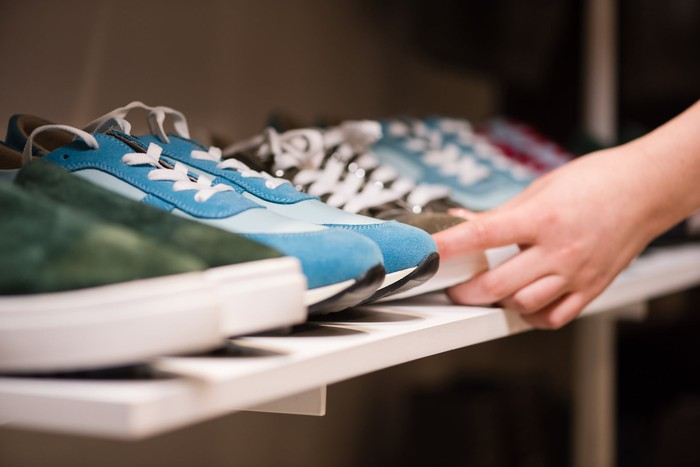 A person shops for new shoes.