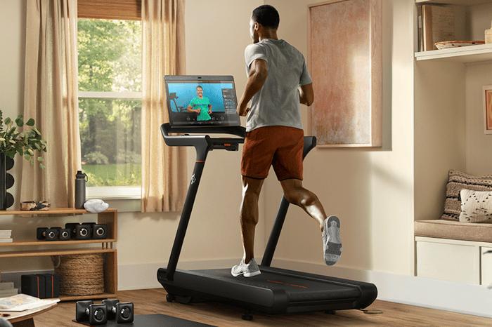 man running on Peloton treadmill