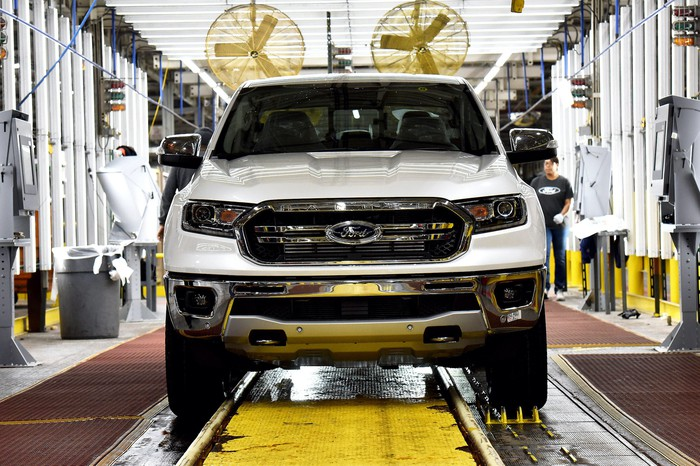 A white Ford Ranger pickup truck moves down the assembly line at Ford's Michigan Assembly Plant in Wayne, Michigan.