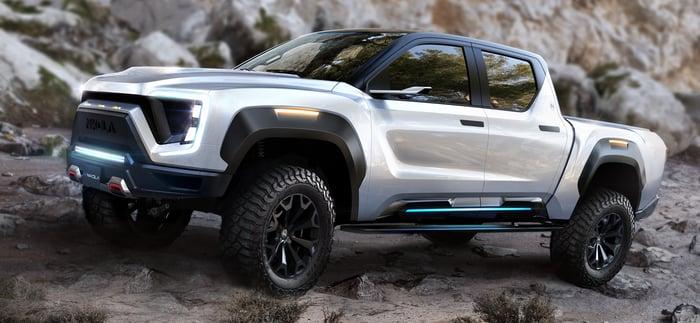 A Nikola pickup truck on rocky terrain