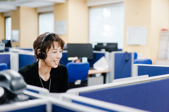 A woman working in a call center.