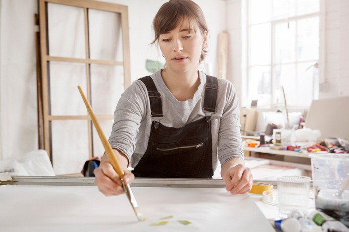 A woman painting.