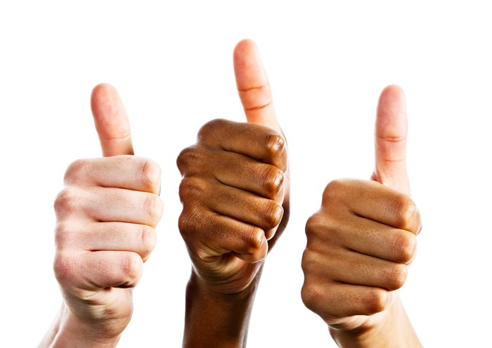 Three hands signal a thumbs up in approval.