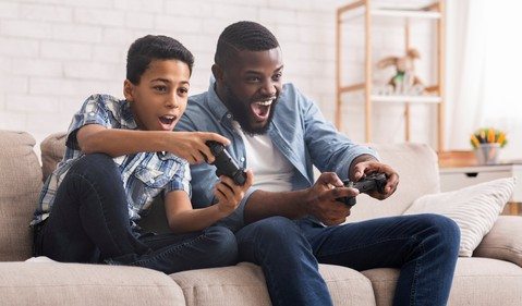 Father and kid playing video games